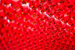 Chinese Red Lanterns hanging in the sky. Big red lanterns with chinese letters written on it. It is believed to bring good luck and happiness to believers Royalty Free Stock Images