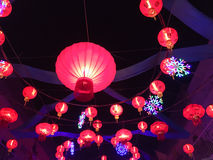 Chinese red lanterns hanging in street at night during the Chine Stock Photo