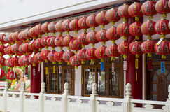 Chinese red ornament in temple. Chinese red ornament decorating on balcony of temple Royalty Free Stock Image