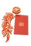 Chinese red packet and fire crackers ornament. Chinese new year red packet and fire crackers ornament on white background Royalty Free Stock Photography
