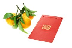 Chinese red packet and mandarin oranges Stock Image
