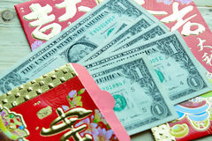 Chinese Red Packet with US Dollar Notes Royalty Free Stock Images