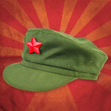 Chinese red star cap with red ray vintage background style Stock Images