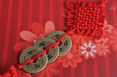 Chinese red tie decoration. Chinese traditional red tie decoration, made by featured red tie and aged copper coin, which means rich and lucky Royalty Free Stock Images
