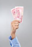 Chinese Renminbi des Geschäftsmannhandgriffs hundert Lizenzfreie Stockbilder