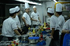 Chinese restaurant - chefs in kitchen Royalty Free Stock Photo