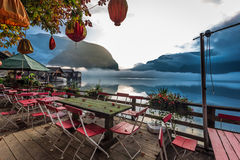 Chinese restaurant on the foggy lake in the Alps Stock Photos