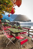 Chinese restaurant on the foggy lake in the Alps Royalty Free Stock Image