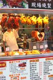 Cook works in a take-away Chinese restaurant, chicken and Peking duck,Hongkong Stock Image