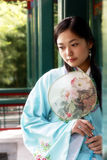 Chinese retro beauty. A beautiful girl in Chinese ancient dress is in the royal garden Royalty Free Stock Images