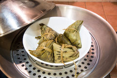 Chinese rice dumplings or zongzi in wok for steaming Stock Photography