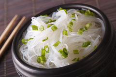Chinese rice noodles with green onions macro in a bowl. horizont Royalty Free Stock Photography