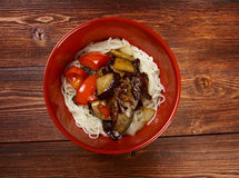 Chinese rice noodles with veal,eggplants Royalty Free Stock Photo