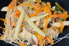 Chinese rice noodles with vegetables Stock Images