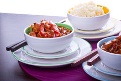 Chinese rice and sweet and sour chicken. Chinese bowls with rice and sweet and sour chicken Stock Photography