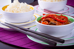 Chinese rice and sweet and sour chicken. Chinese bowls with rice and sweet and sour chicken Royalty Free Stock Images
