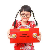 Chinese rich girl. Happy chinese new year. smile asian girl holding red safe box isolated on white background Stock Photo