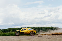 Chinese riders on rally car driving on dust road Royalty Free Stock Image