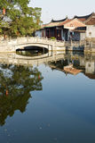 Chinese river, village and bridge Royalty Free Stock Image