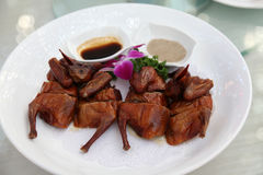Chinese roast pigeon Stock Photo
