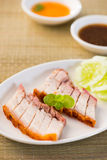 Chinese roast pork close up shot served with chilli sauce Stock Photos