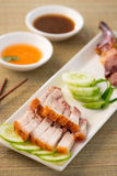 Chinese roast pork close up shot served with chilli sauce Stock Images
