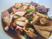 Chinese roll noodle soup or Kuay jub, one of Thai street food that contained noodles roll, pork livers, pork blood, pork kidney, b. Oiled eggs and meat. Large royalty free stock photography
