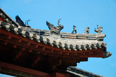 Chinese Roof. Edge of a chinese temple roof architecture with little figures on it stock photo