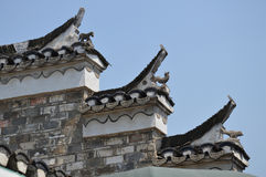 Chinese roof architecture and art. Bricks, tiles and figurines used to decorate a roof in Sanhe Ancient town, China. Picture taken May 2014 Royalty Free Stock Images