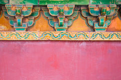 Chinese Roof Detail. Chinese Roof Detail featuring traditional roof support construction on a bright red wall Royalty Free Stock Image