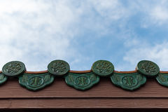 Chinese roof style on blue sky. Background Royalty Free Stock Image