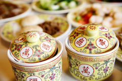 Chinese royal tableware. Exquisite Chinese royal soup cups on the table,it once was the Chinese imperial family special-purpose tableware Royalty Free Stock Image