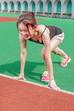 Chinese runner at starting position on racetrack Stock Photography