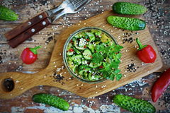 Chinese salad with broken cucumber, chilli and sesame. Seeds on an old wooden table and fresh vegetables Stock Image