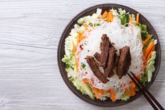 Chinese salad with rice noodles, meat and vegetables top view Royalty Free Stock Photos