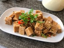 Chinese salt and chilli tofu, traditional dish of Chinese food. serving at restaurant royalty free stock photography