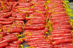 Chinese sausage are drying on sunlight Stock Image