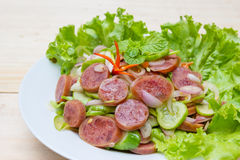 Chinese Sausage Salad on wood background Royalty Free Stock Images