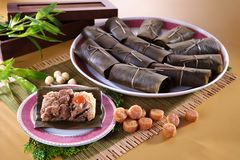 Chinese scallop cake on traditional plate in restaurant royalty free stock photo