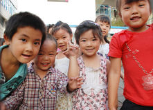 Chinese school children. Smiling young Chinese children in the school, in Sichuan,China stock photo