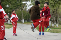 Chinese school children play in park Stock Photo