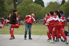 Chinese school children play in park Stock Photography