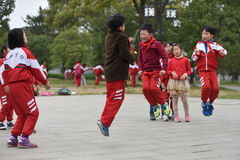 Chinese school children play in park Royalty Free Stock Photo