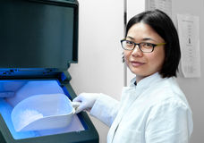 Oriental scientist by ice machine Stock Photos