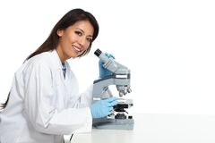 Chinese scientist woman with microscope. Chinese scientist woman working with microscope in laboratory Royalty Free Stock Image