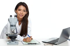 Chinese scientist woman with microscope. Chinese scientist woman working with microscope in laboratory Royalty Free Stock Photos