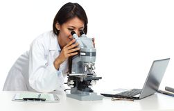 Chinese scientist woman with microscope. Chinese scientist woman working with microscope in laboratory Royalty Free Stock Photography