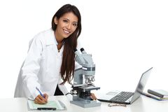 Chinese scientist woman with microscope. Chinese scientist woman working with microscope in laboratory Royalty Free Stock Photo