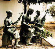 Chinese Sculptures symbolizing Music. And Chinese traditions stock photos