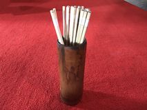 Chinese Seam-Si, Chi-Chi sticks, fortune sticks in wooden tube stock photo